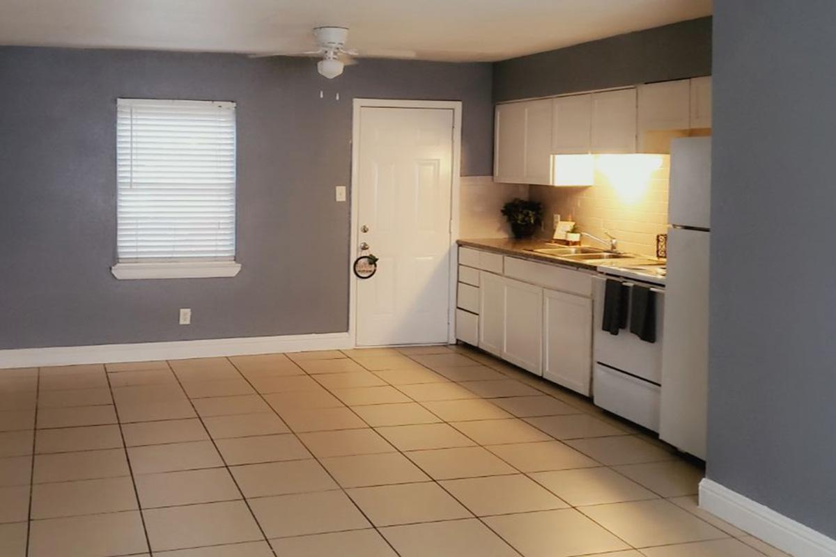 a kitchen with a tiled floor
