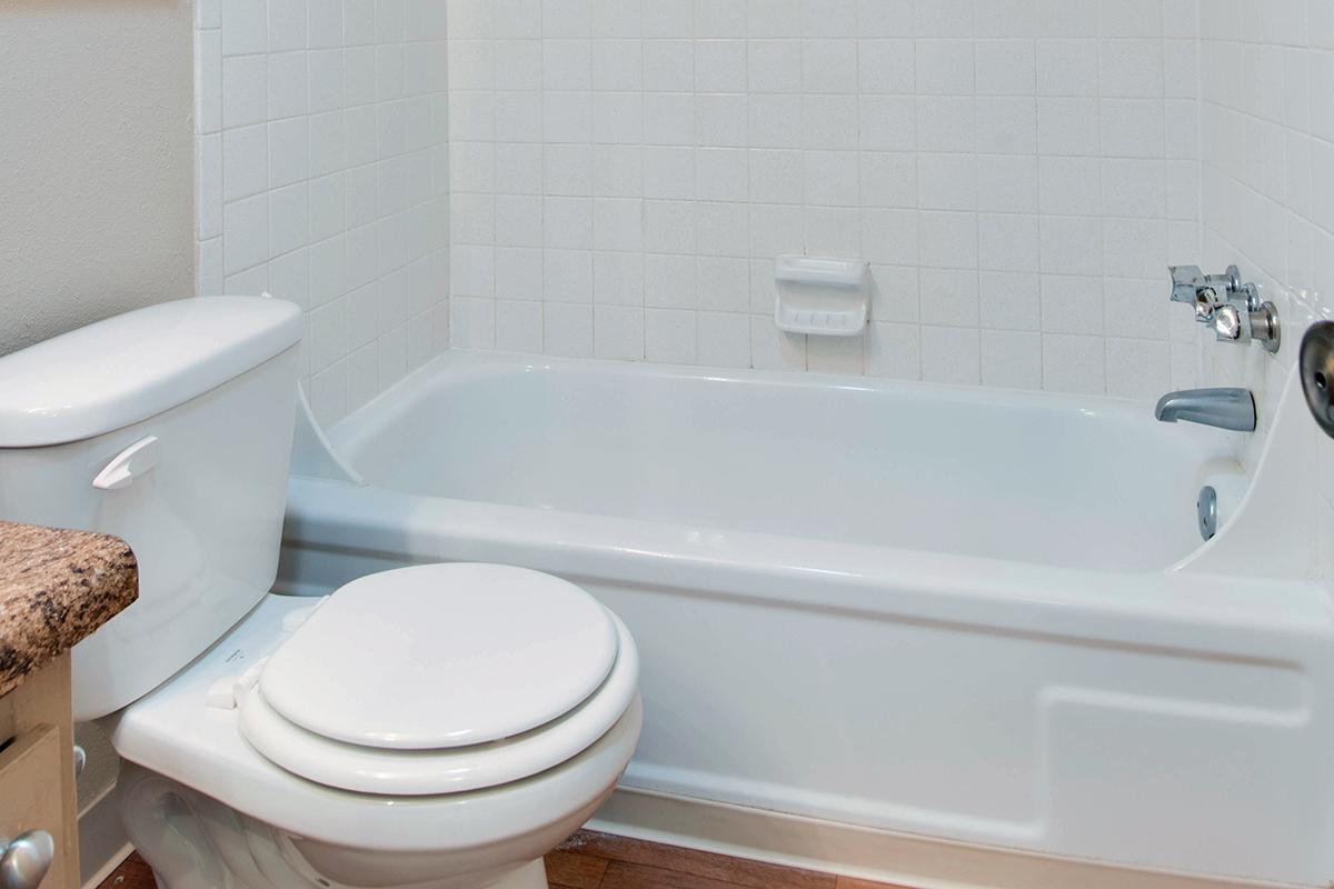 a close up of a sink and a bath tub