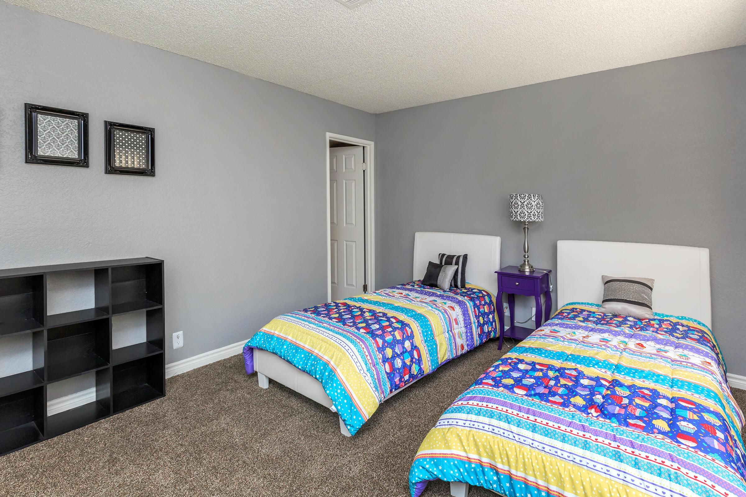 a bedroom with a colorful blanket