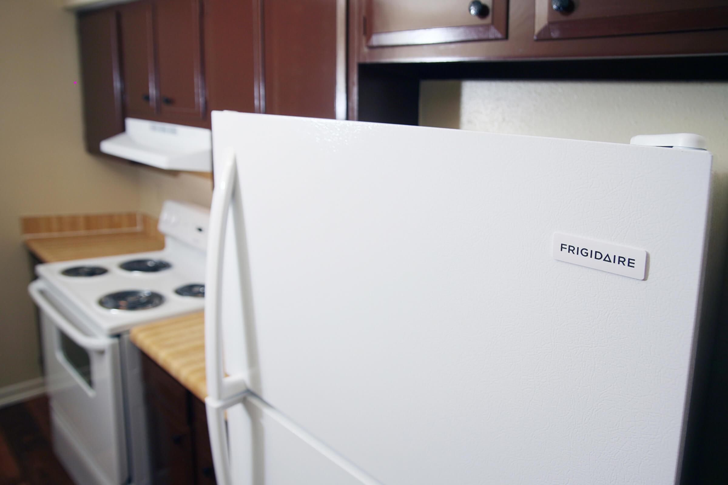 a white refrigerator freezer sitting in a box