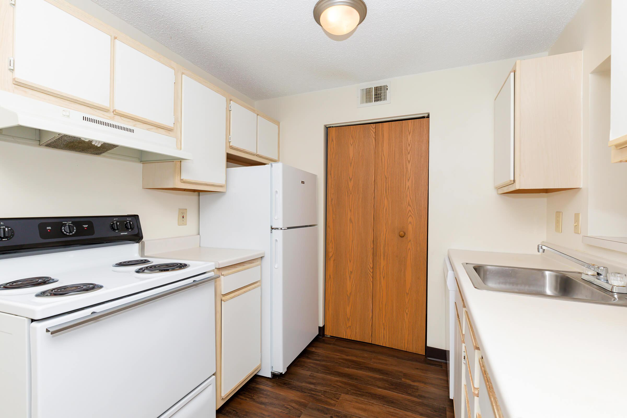 a kitchen with a stove oven and refrigerator