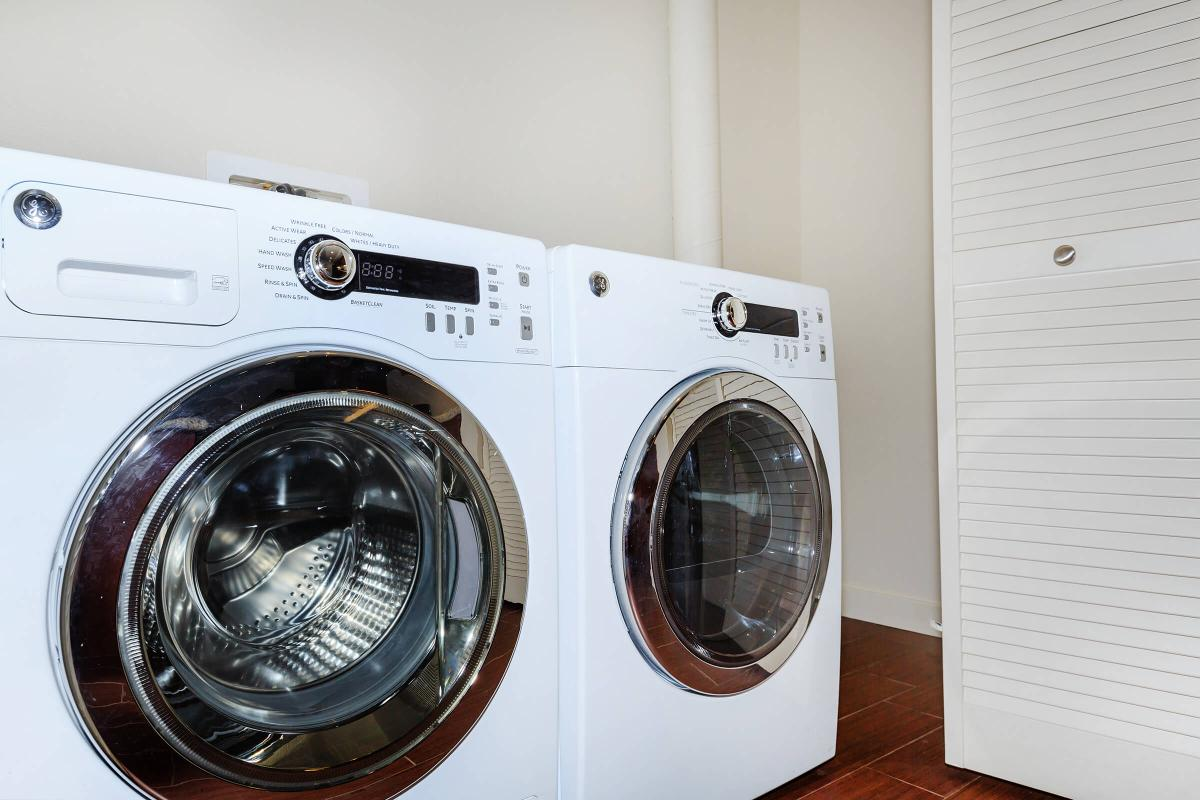 a washer and dryer next to a door