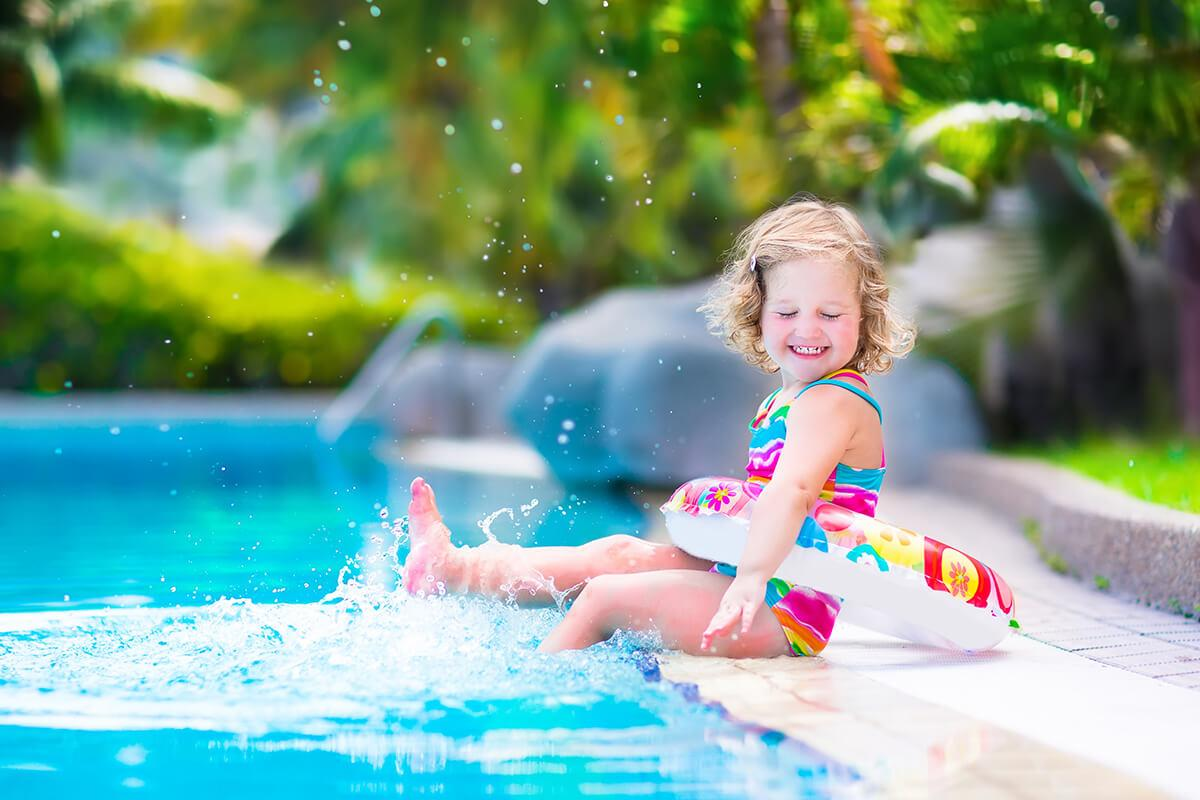 a young girl in a pool of water