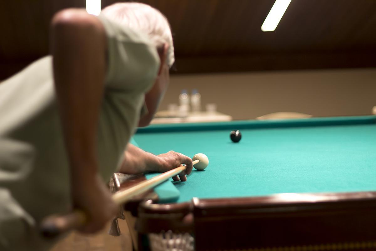 Senior man playing snooker.jpg