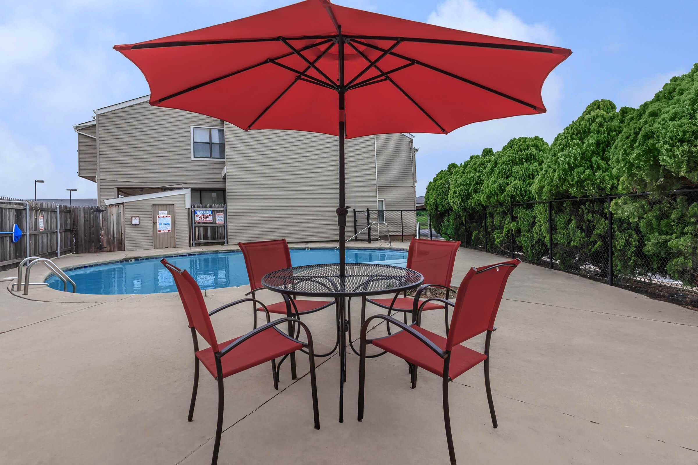 a large red umbrella sitting on top of a chair