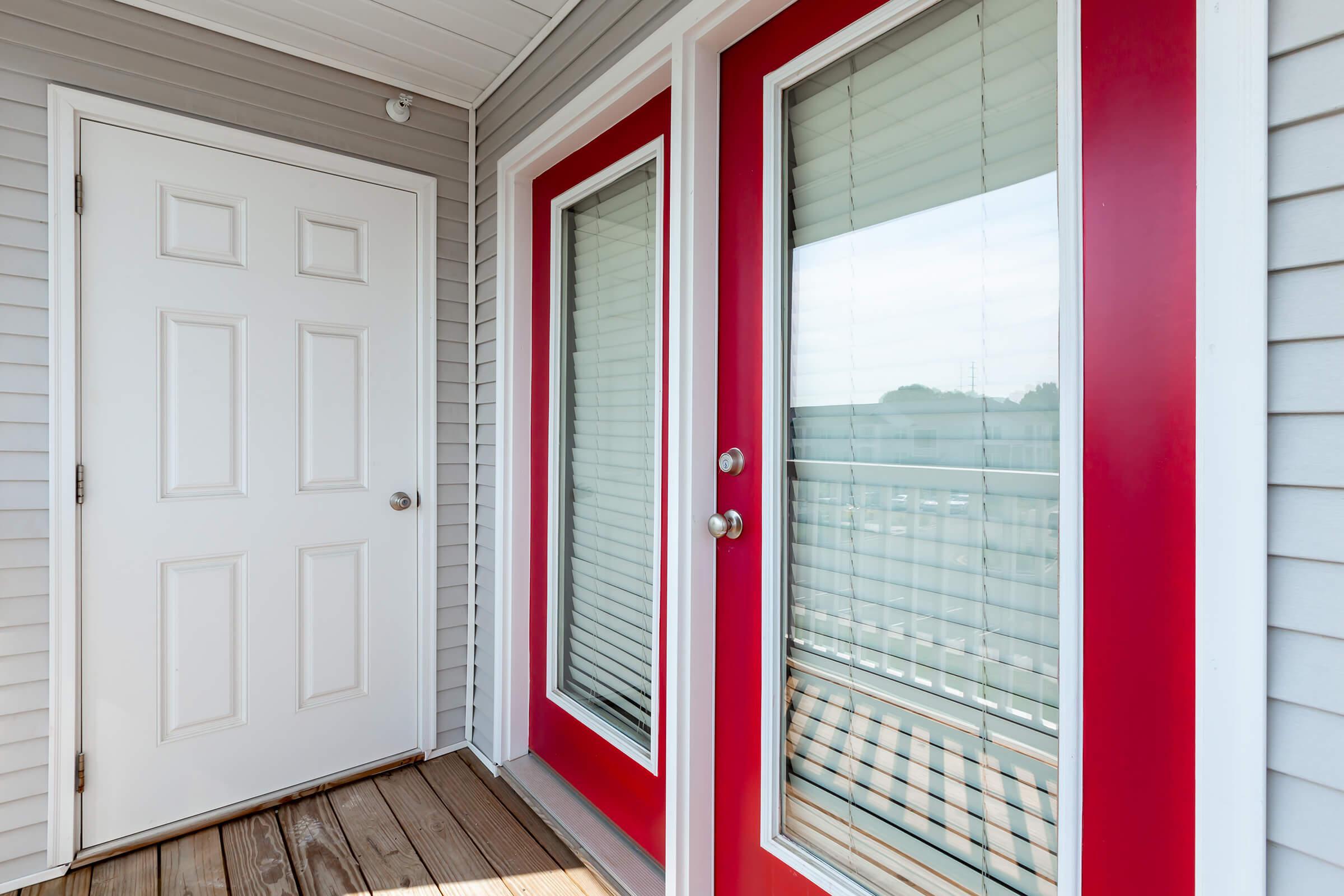 a close up of a red door