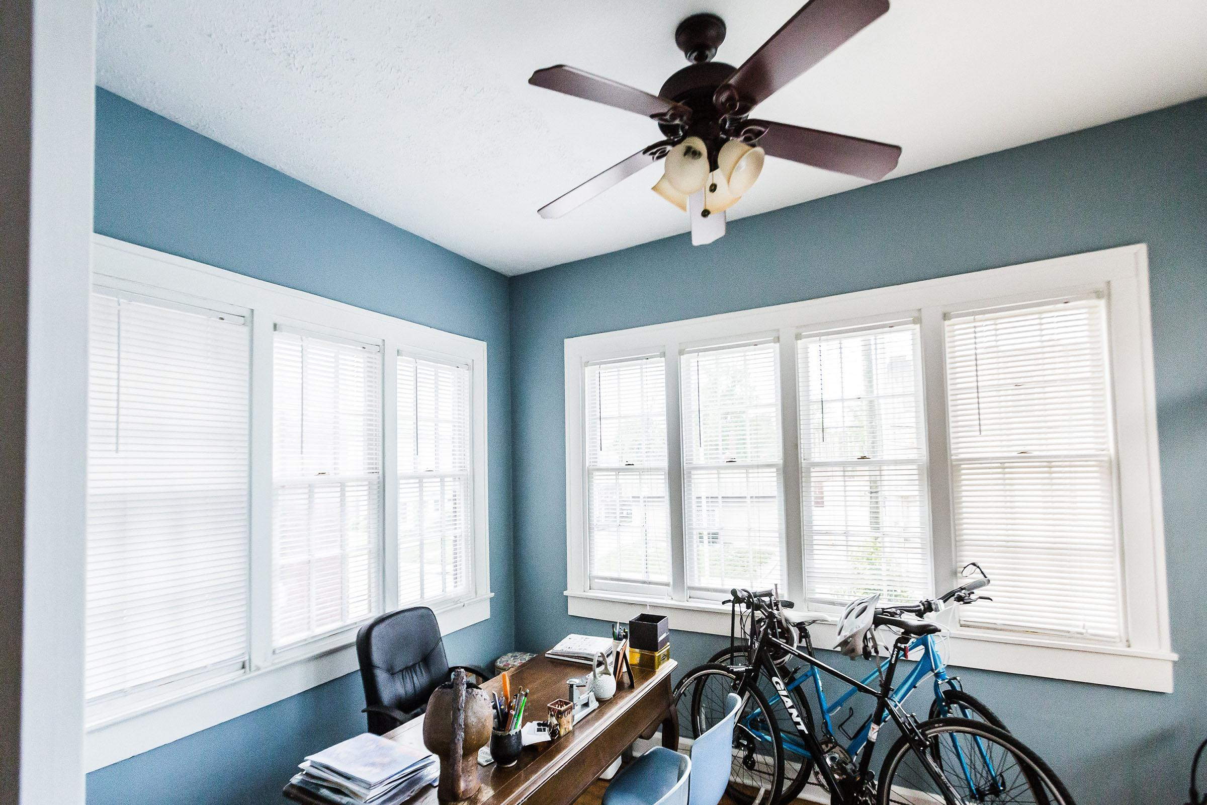 a room with a bicycle in front of a window