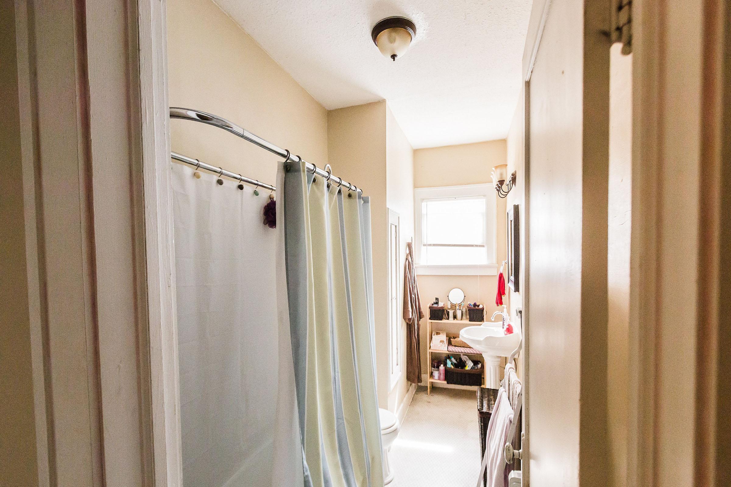 a shower curtain next to a door