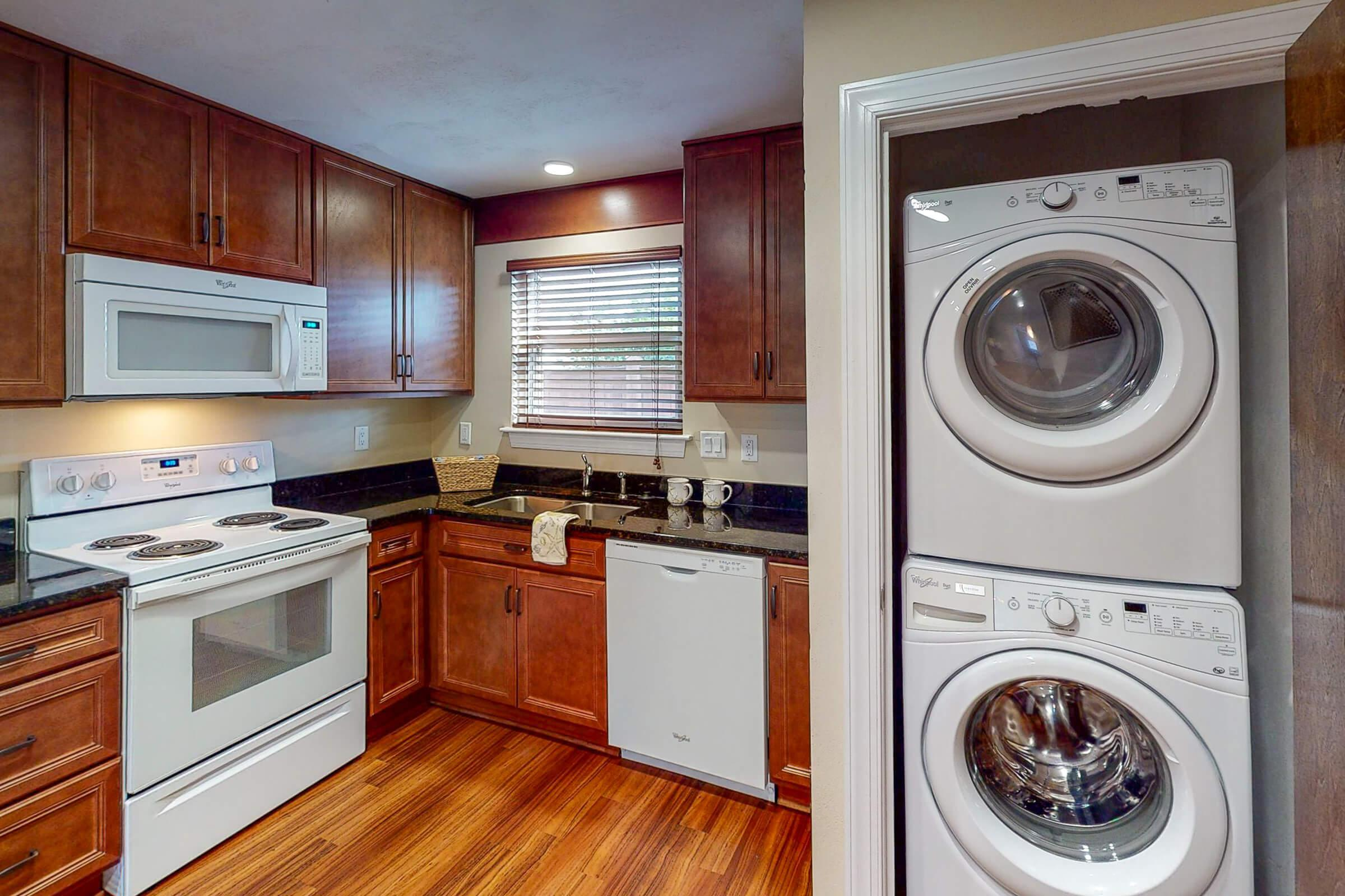 a kitchen with a stove and a microwave oven
