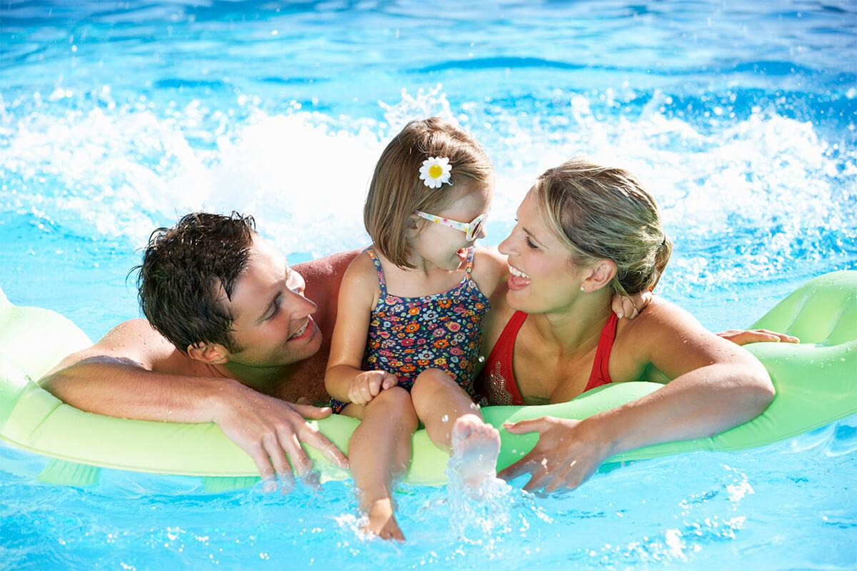 family having fun in the swimming pool iStock-171578745.jpg