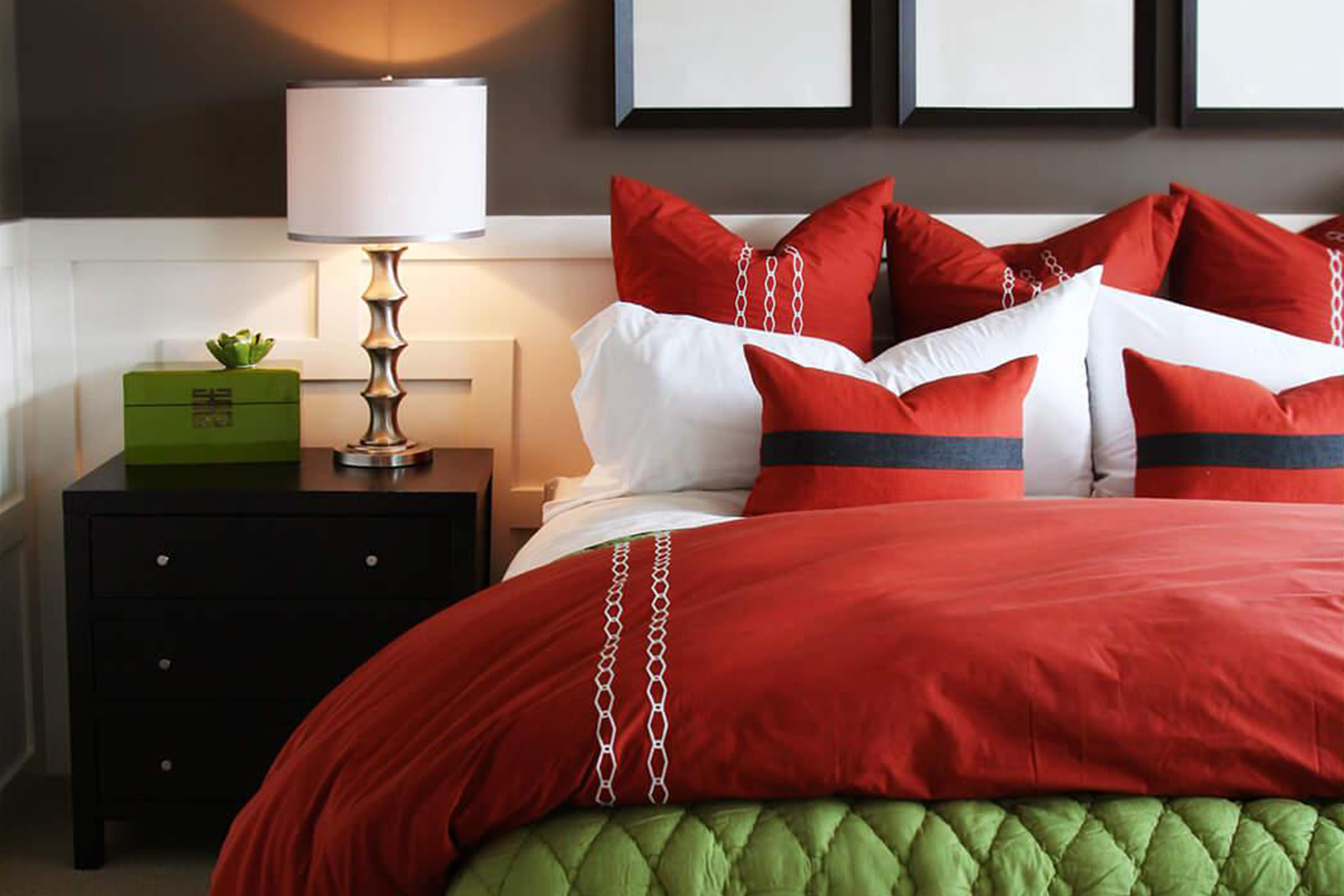 a large red bed in a hotel room