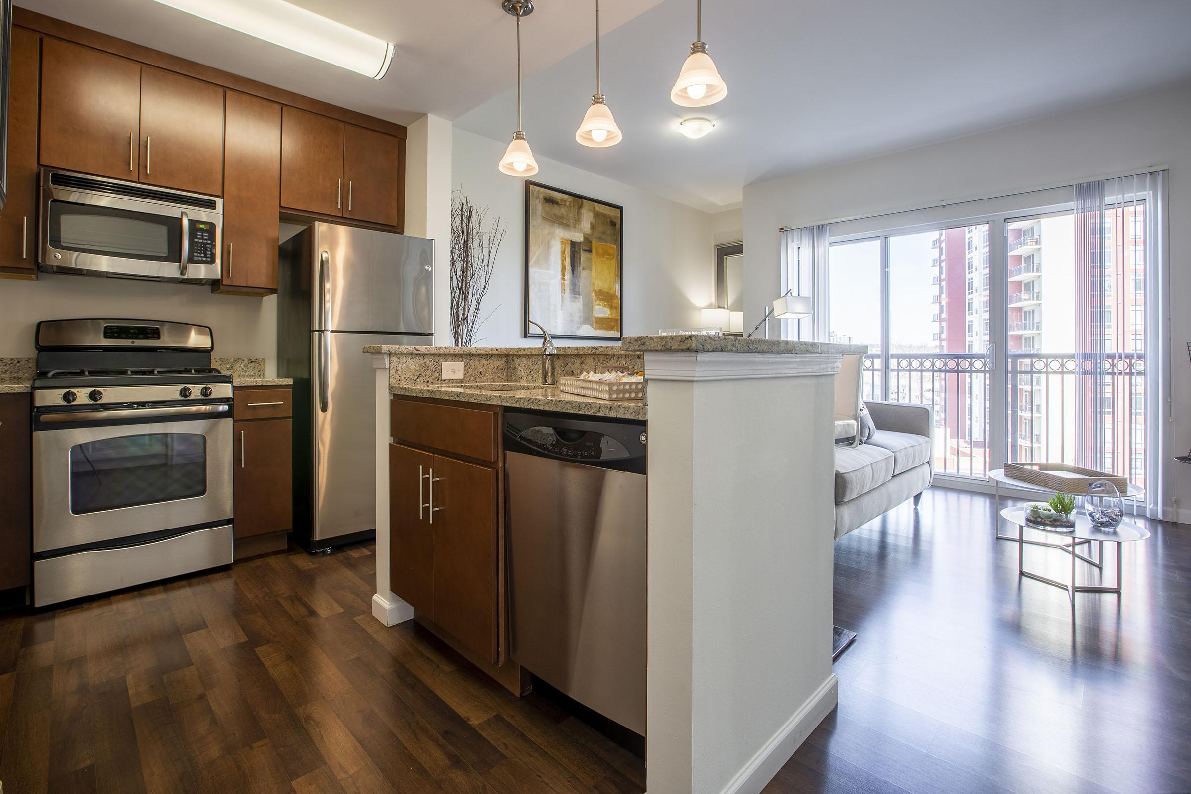 a room filled with furniture and a stove in a kitchen