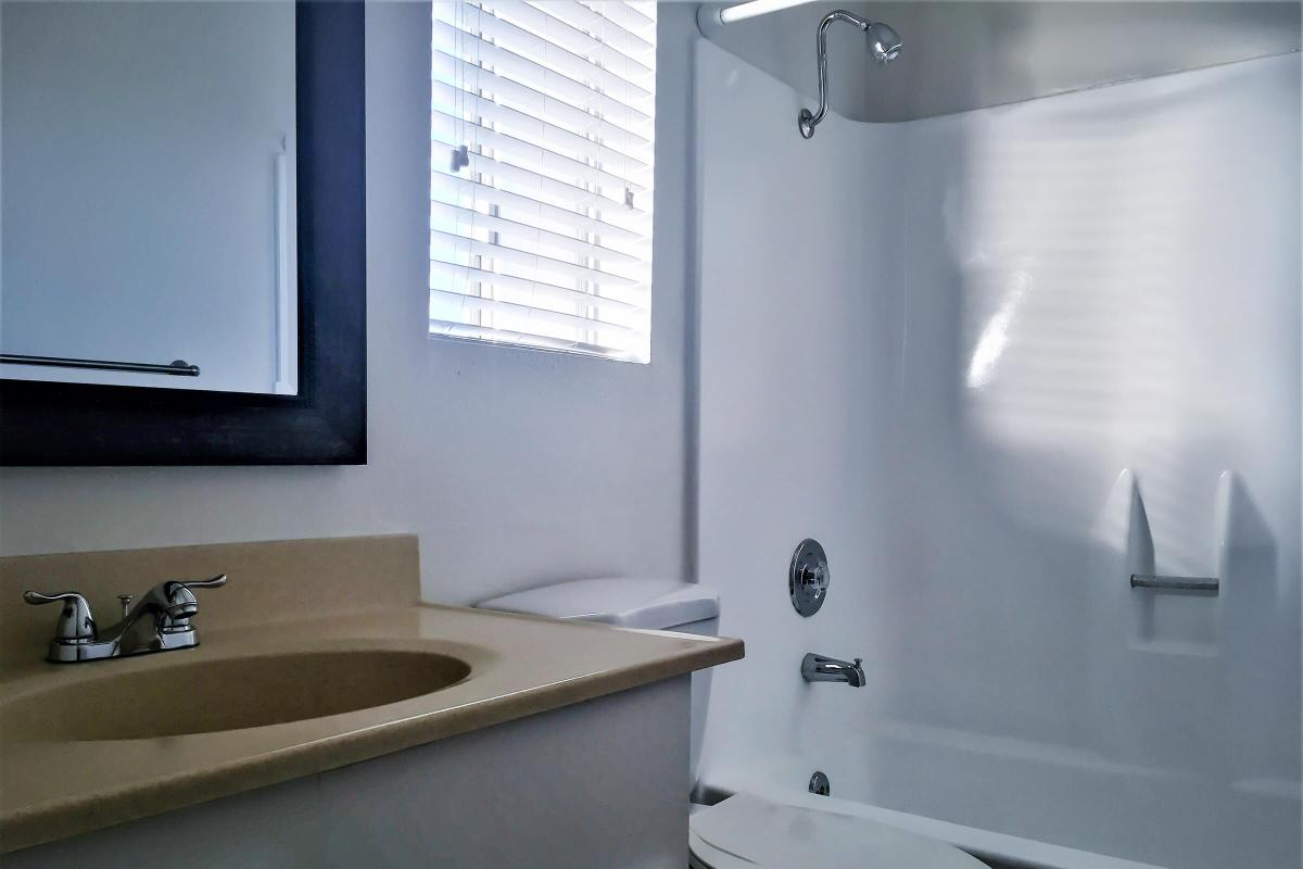 a white sink sitting next to a window
