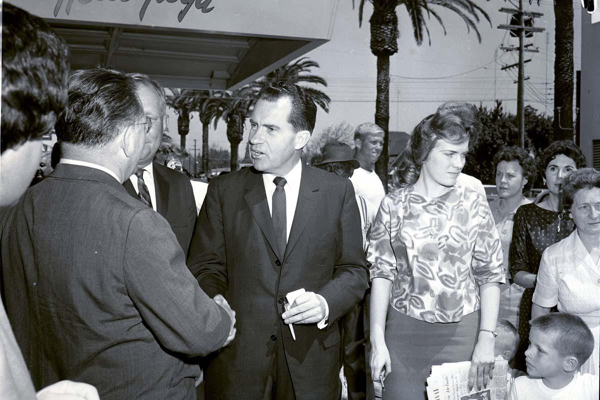 Richard Nixon et al. posing for the camera