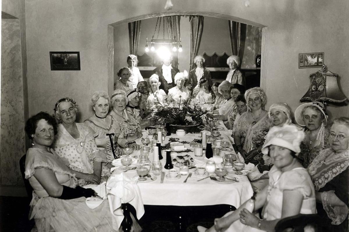 a group of people sitting at a table posing for a photo