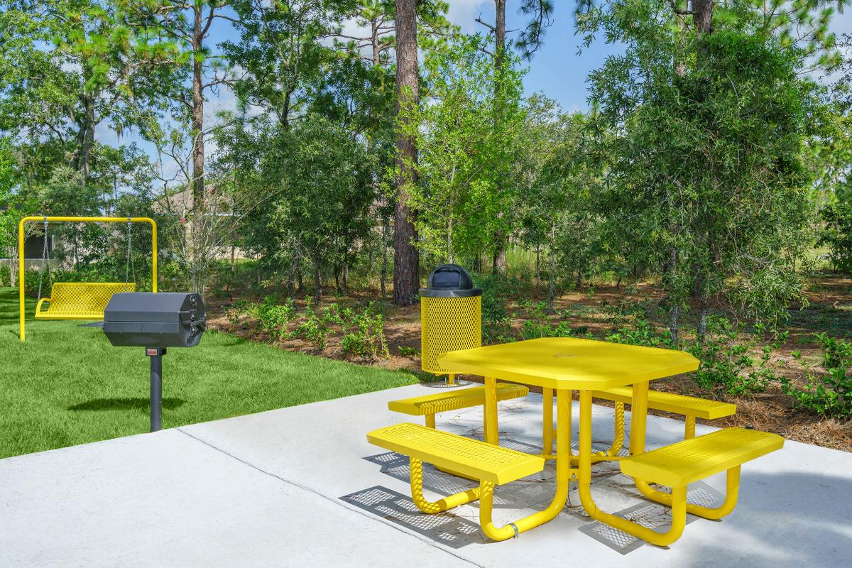 a yellow bench sitting on top of a picnic table