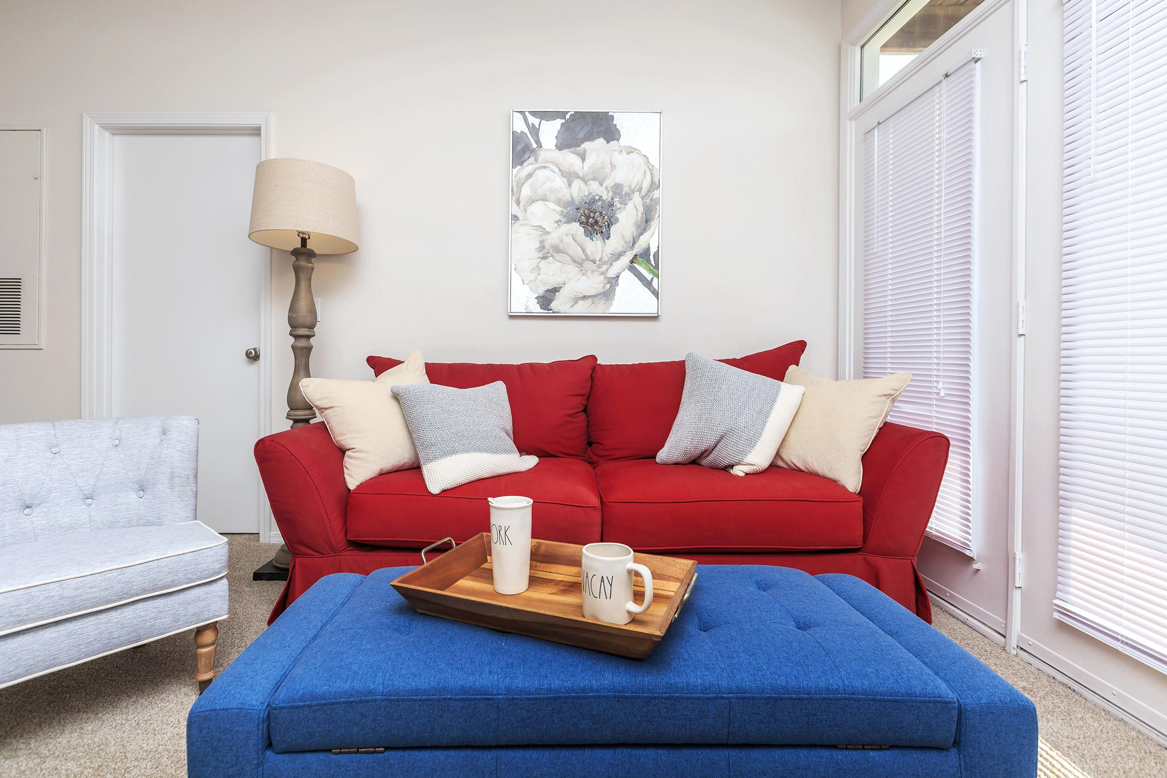 a living area with red and blue furniture