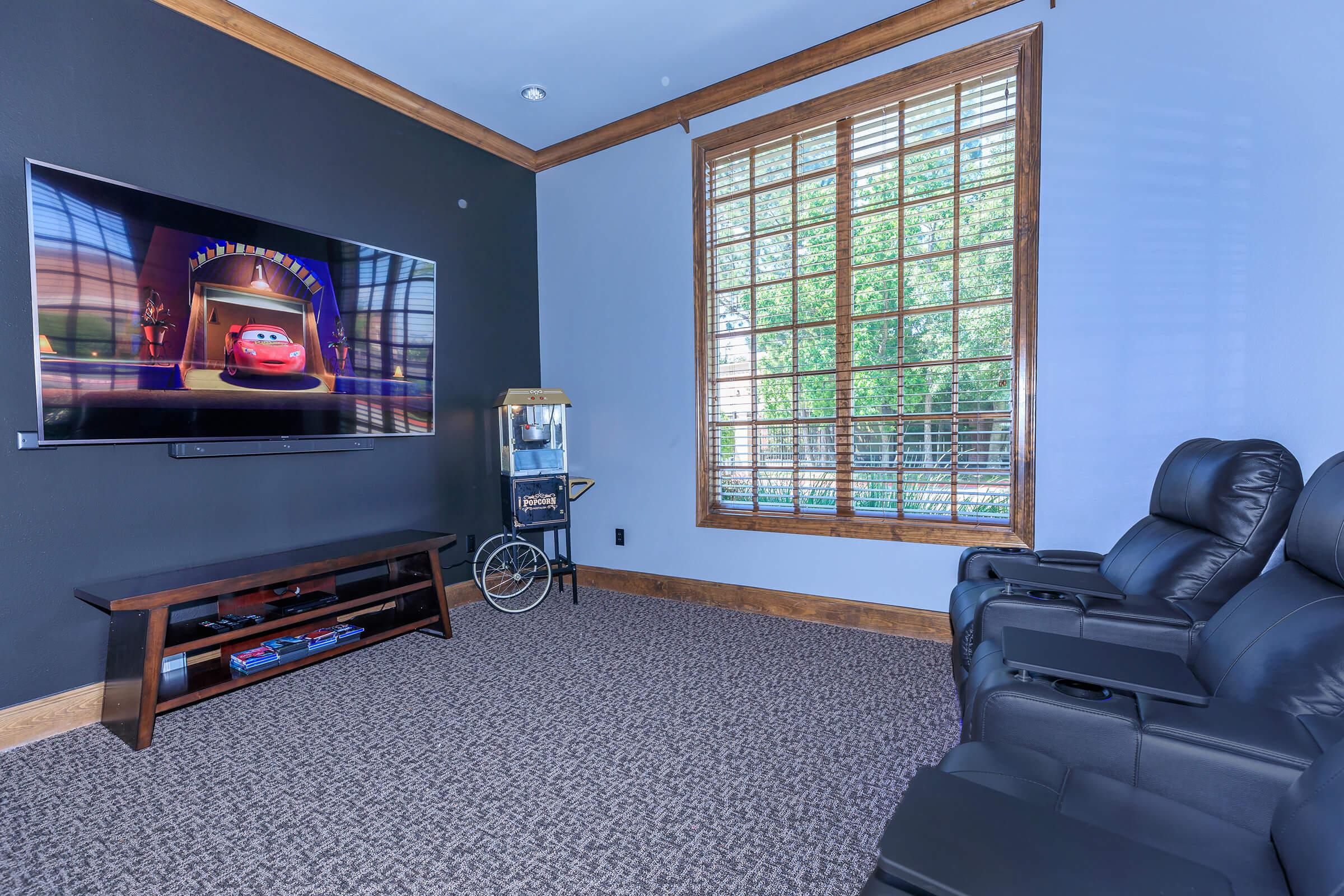 a living room with a television and a window