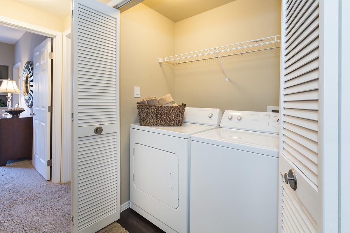 a white refrigerator freezer sitting next to a window
