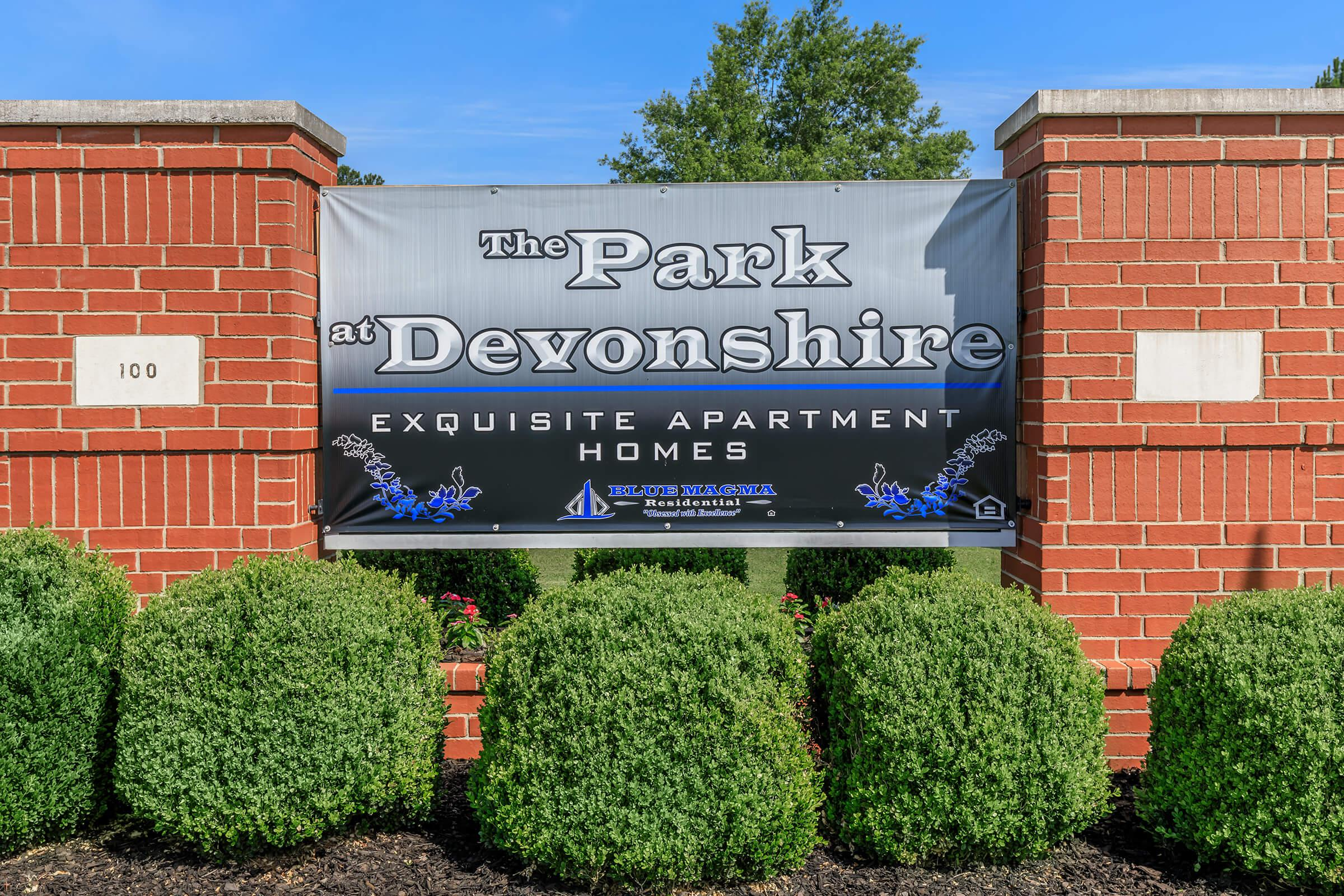a sign in front of a brick building