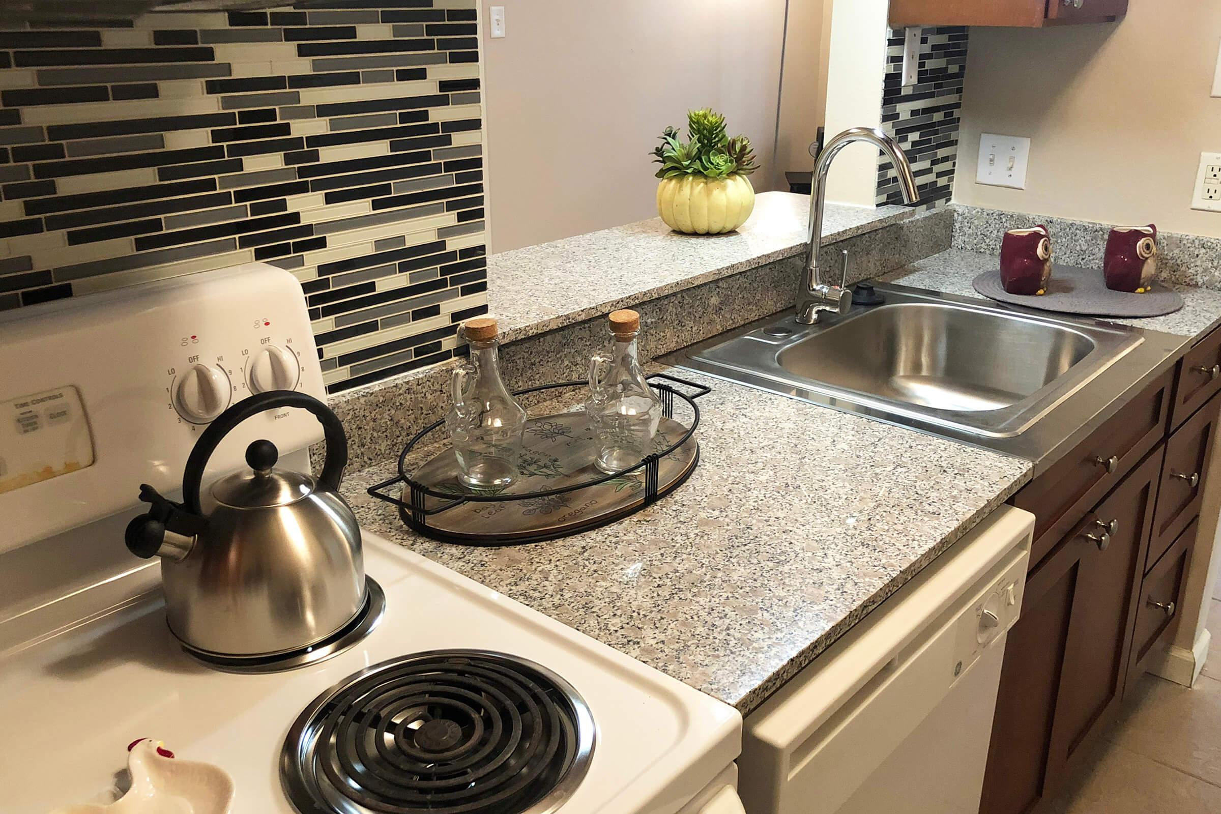 a stove top oven sitting inside of a kitchen counter