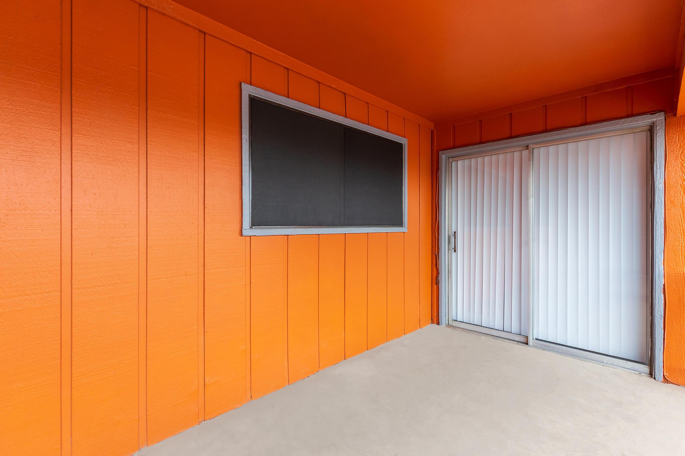 a close up of an orange door