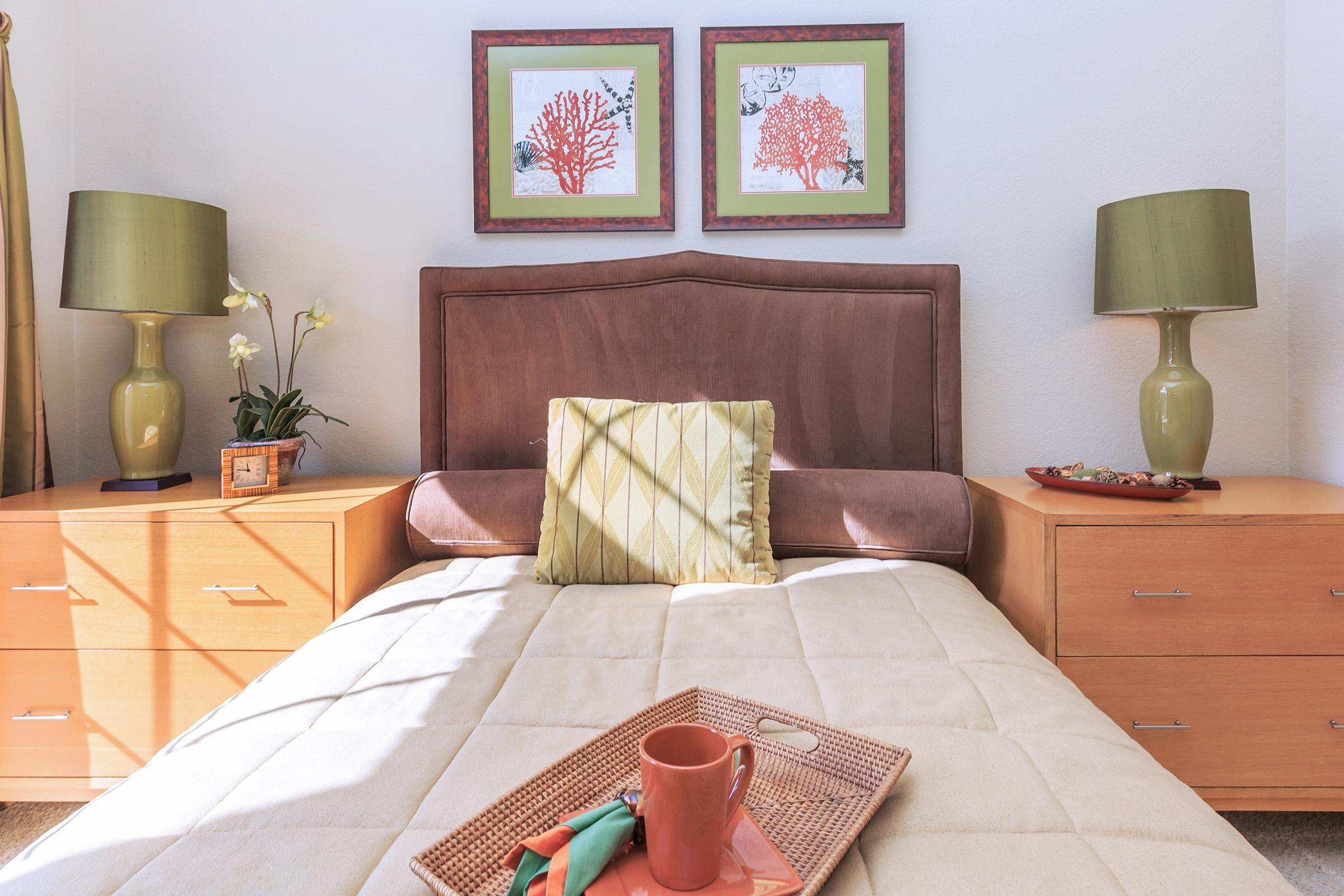 a bedroom with a bed and a table