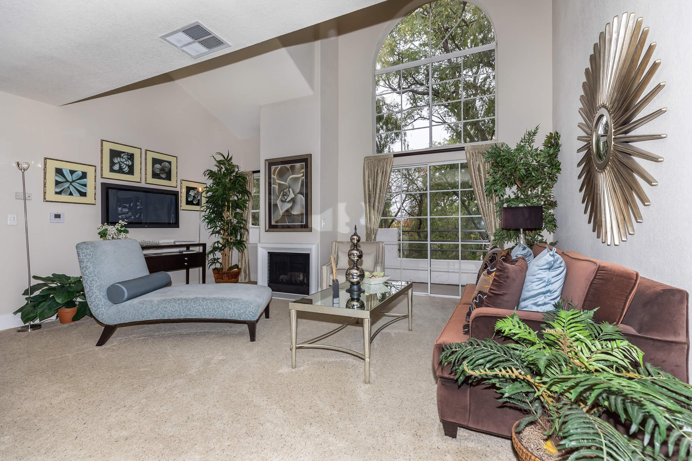 a living room filled with furniture and decor