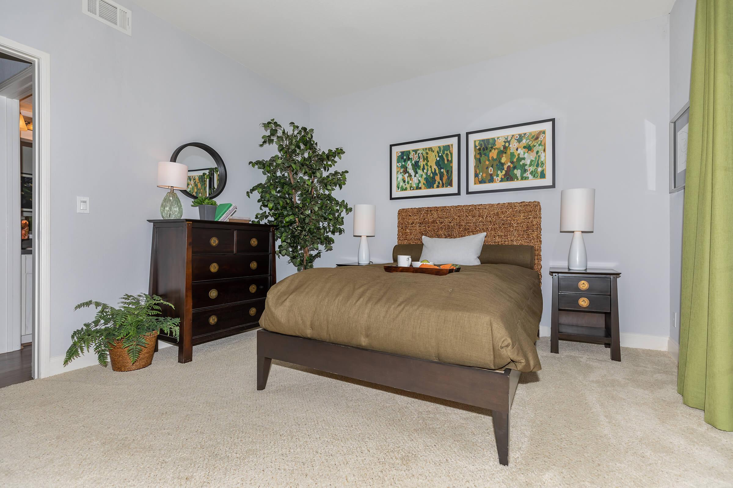 a bedroom with a bed and a couch in a living room