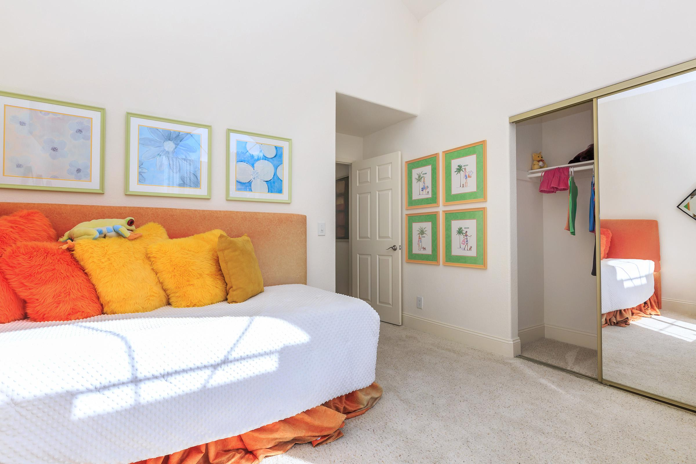 a bedroom with a stuffed animal on a bed