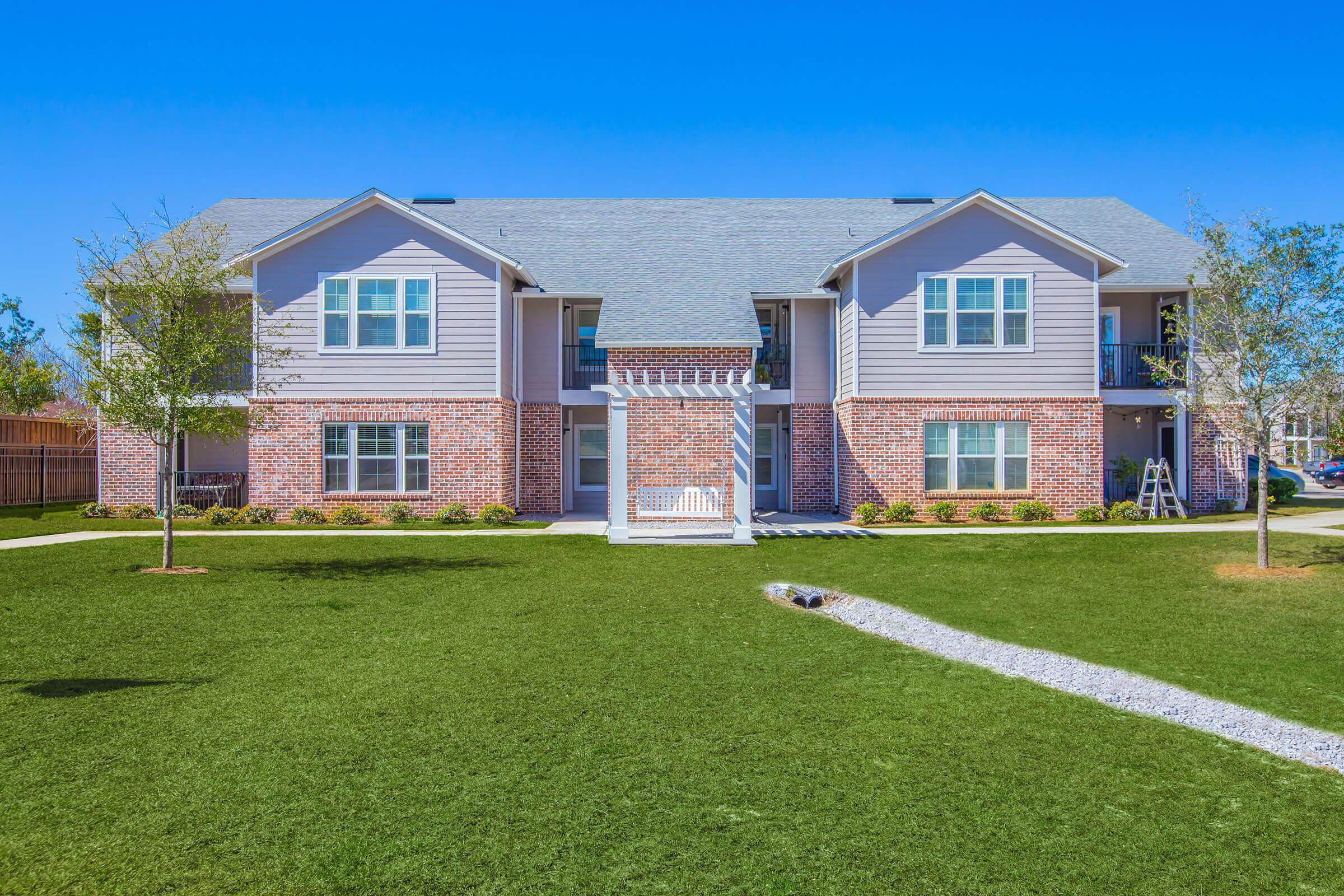 a large lawn in front of a house