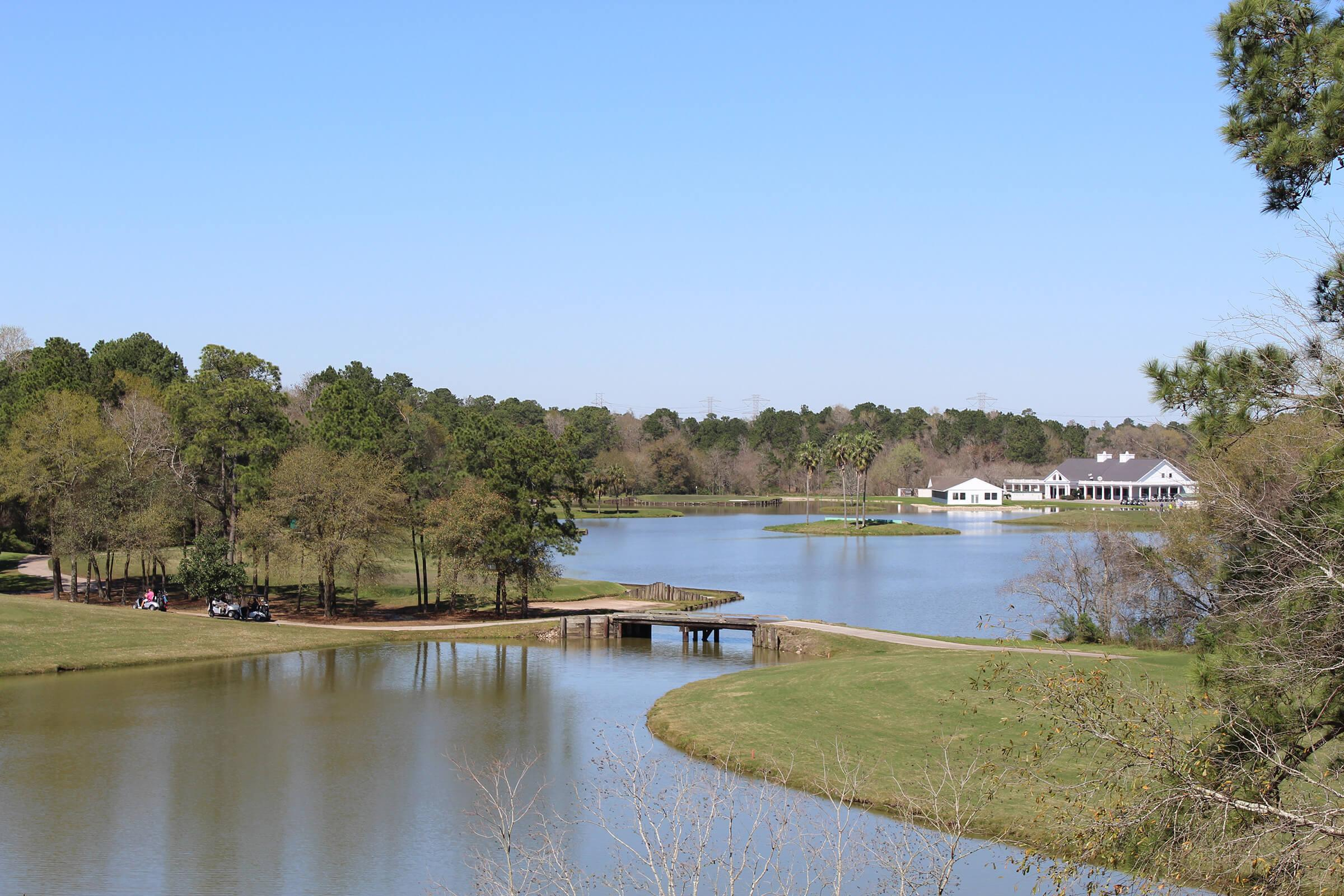 Golf course lake view. Large lake with small bridge spanning for golf carts