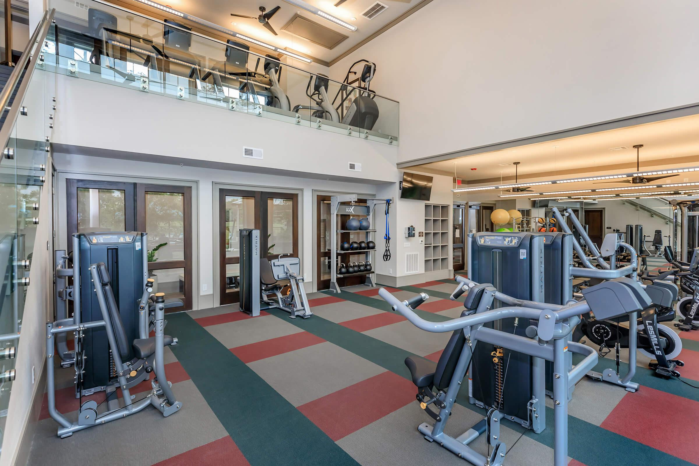2-story state-of-the-art fitness center showing equipment from first floor with second floor visible