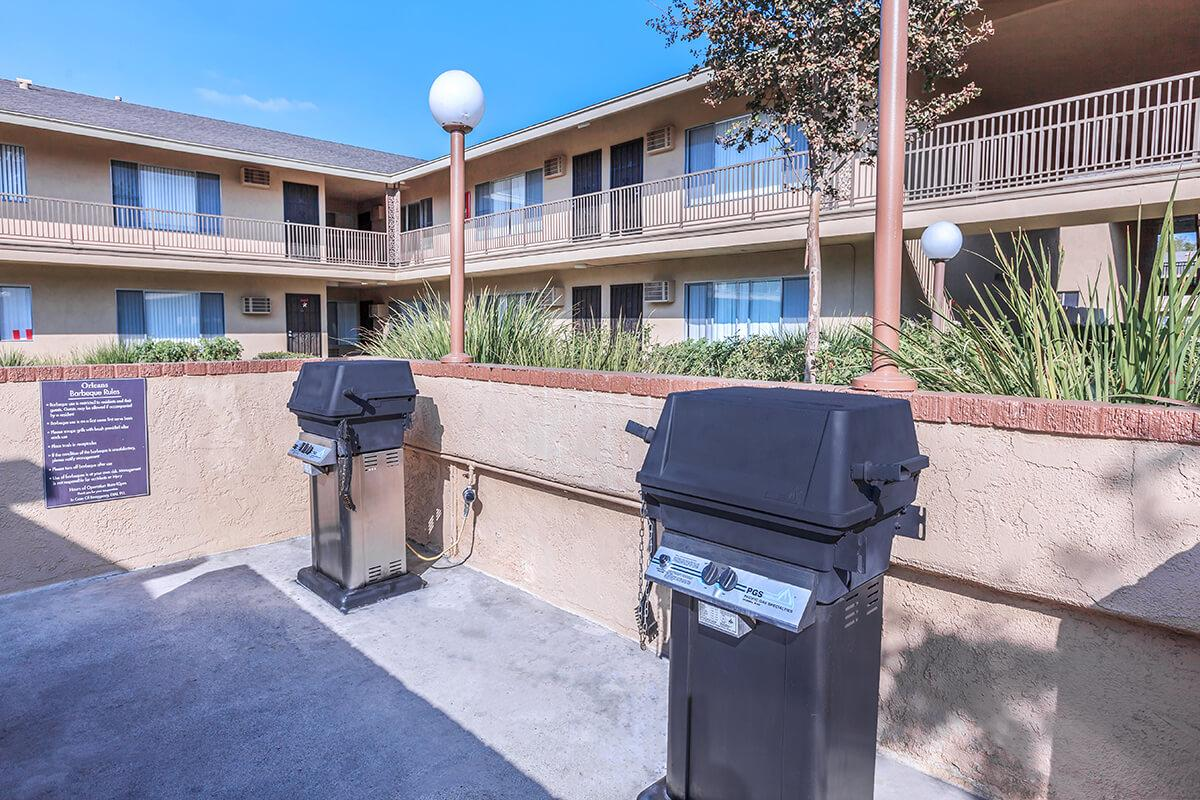 Two barbecues next to the community buildings