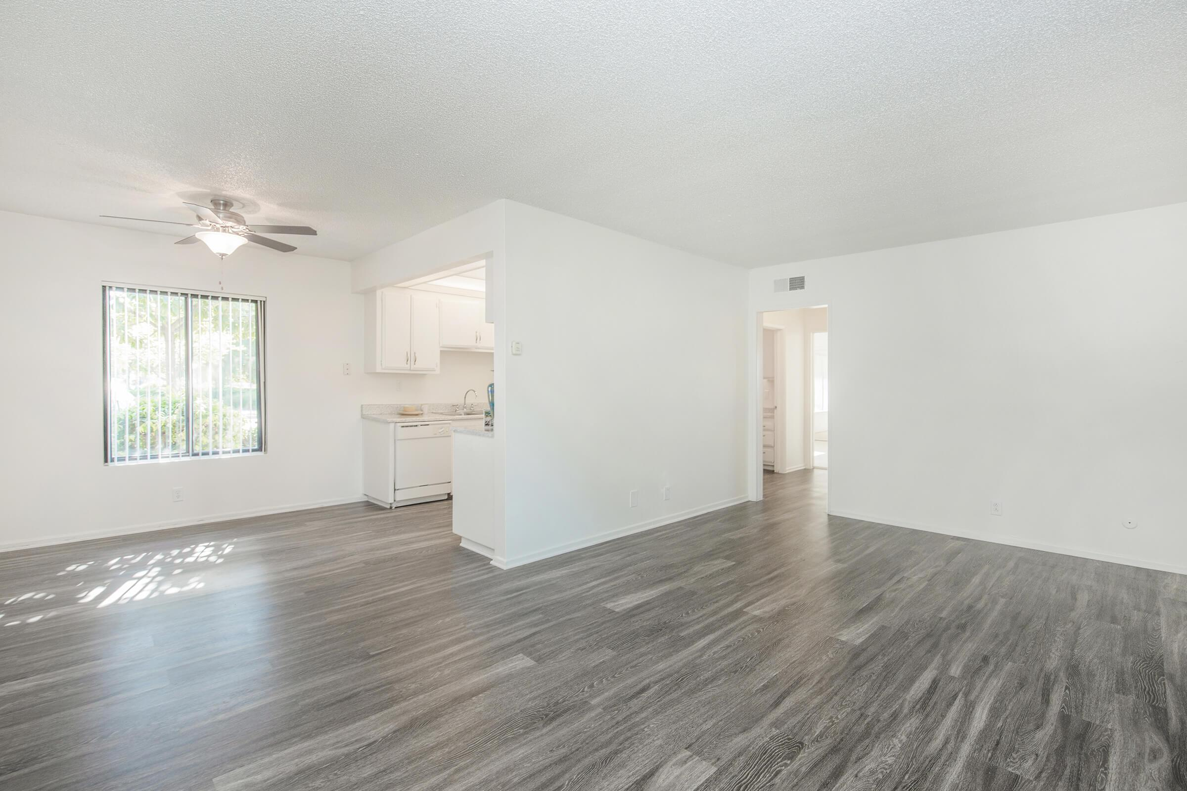 Unfurnished living room with wooden floors