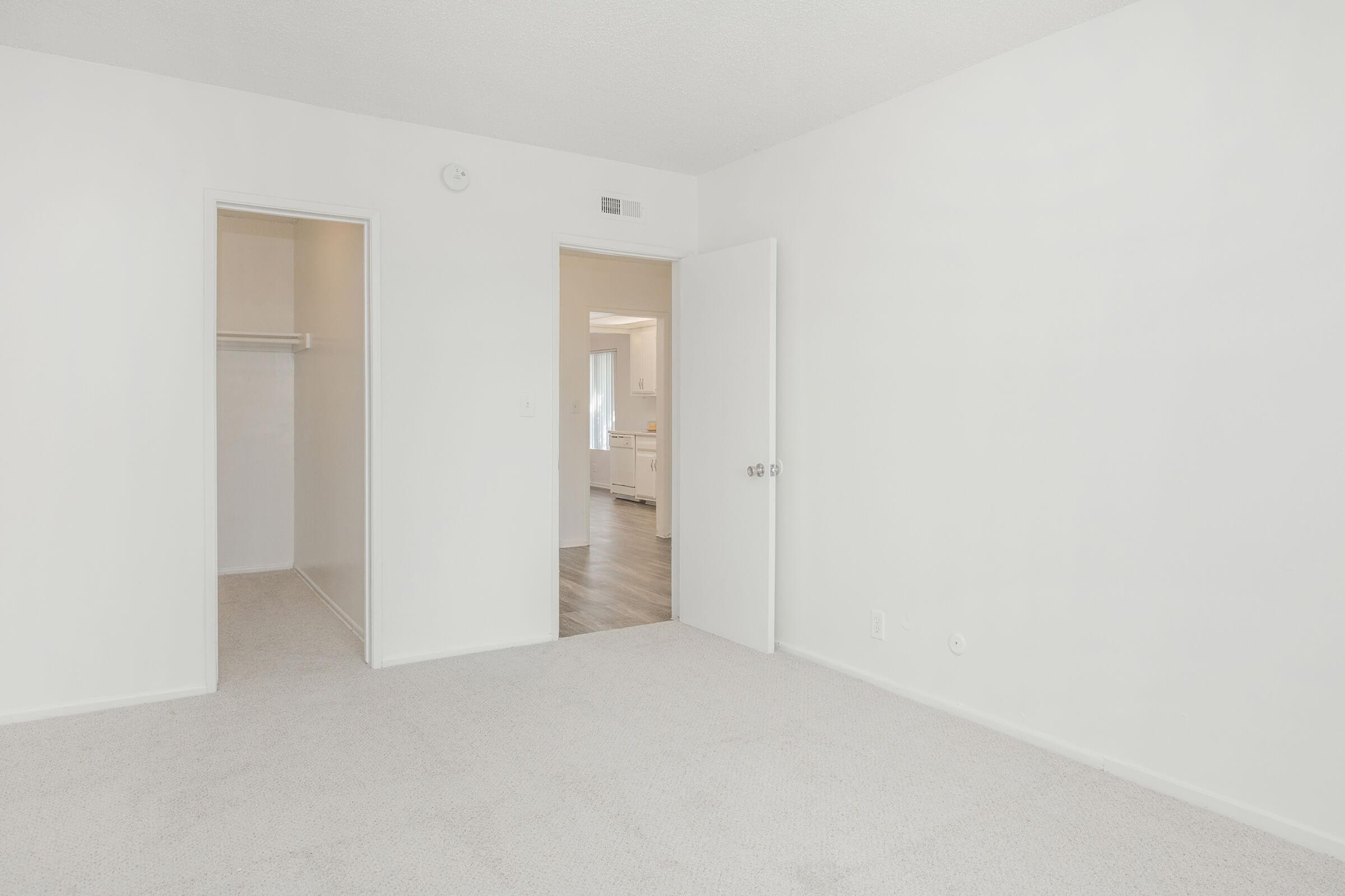 Bedroom with open walk-in closet door