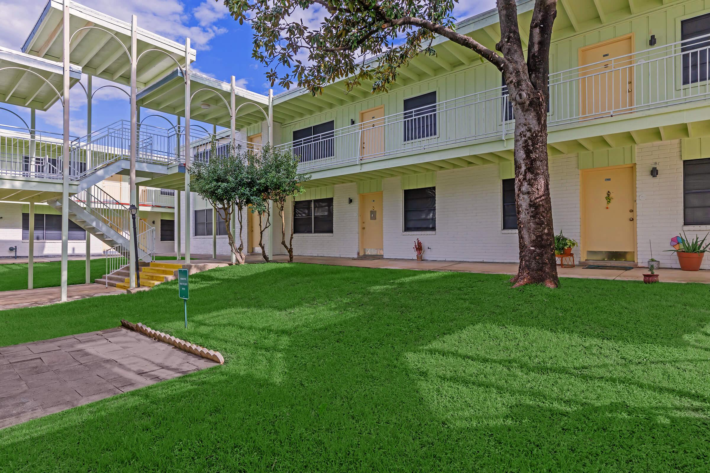 a large lawn in front of a building