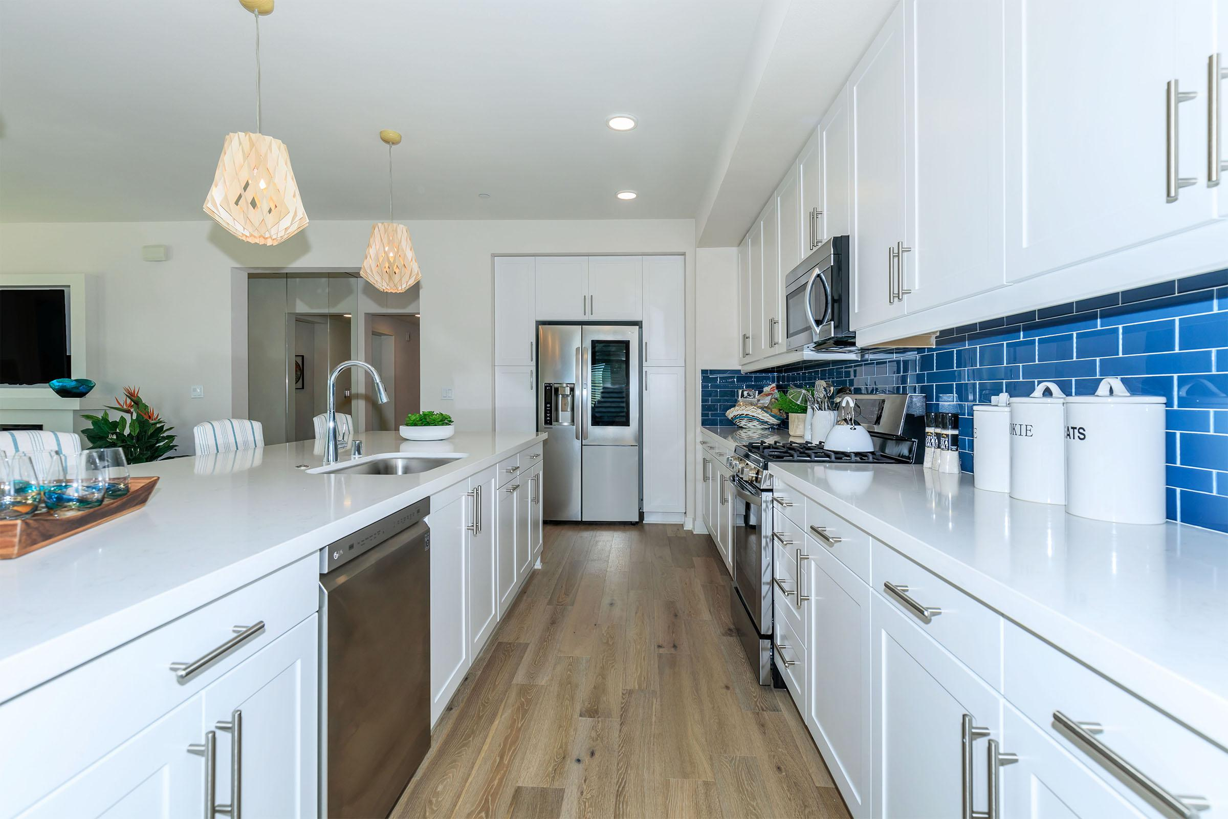 a kitchen with a white counter