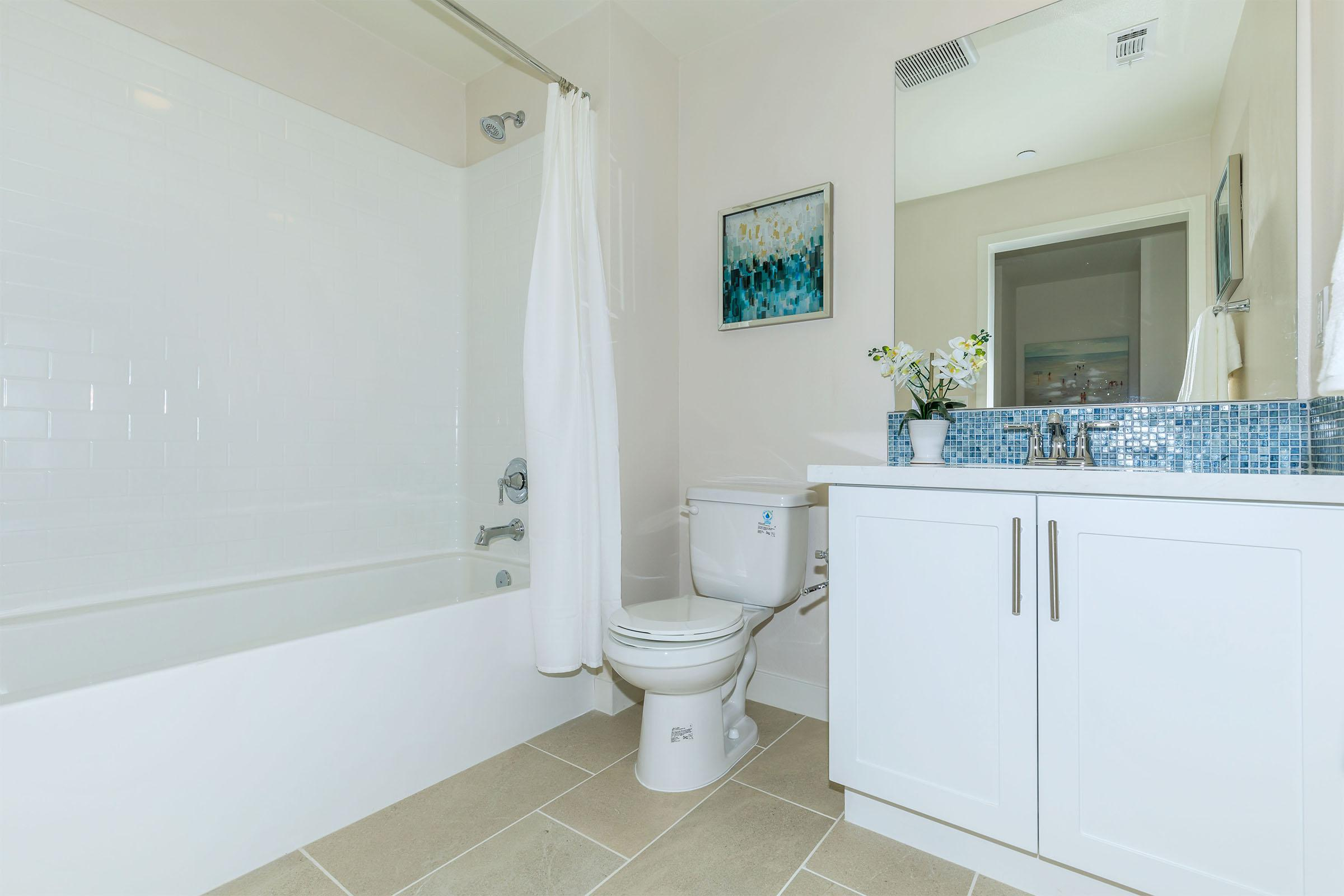 a large white tub next to a sink