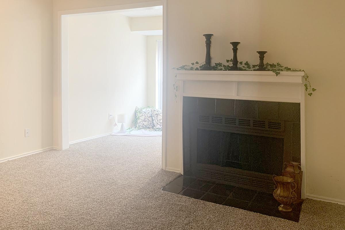 a large empty room with a fireplace