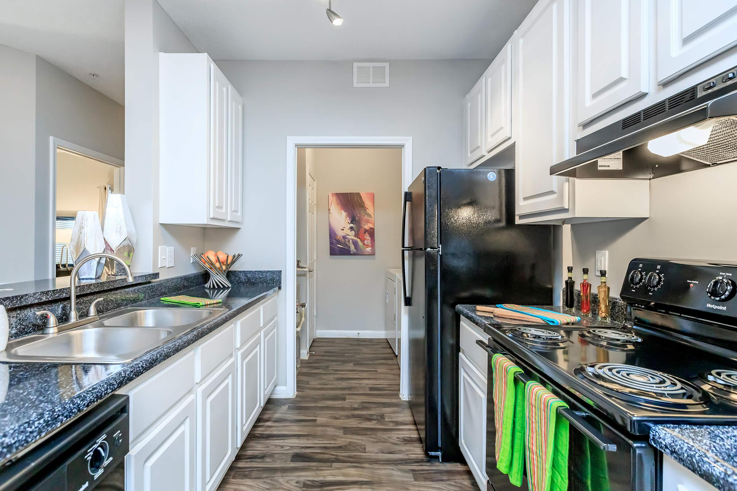 a modern kitchen with stainless steel appliances