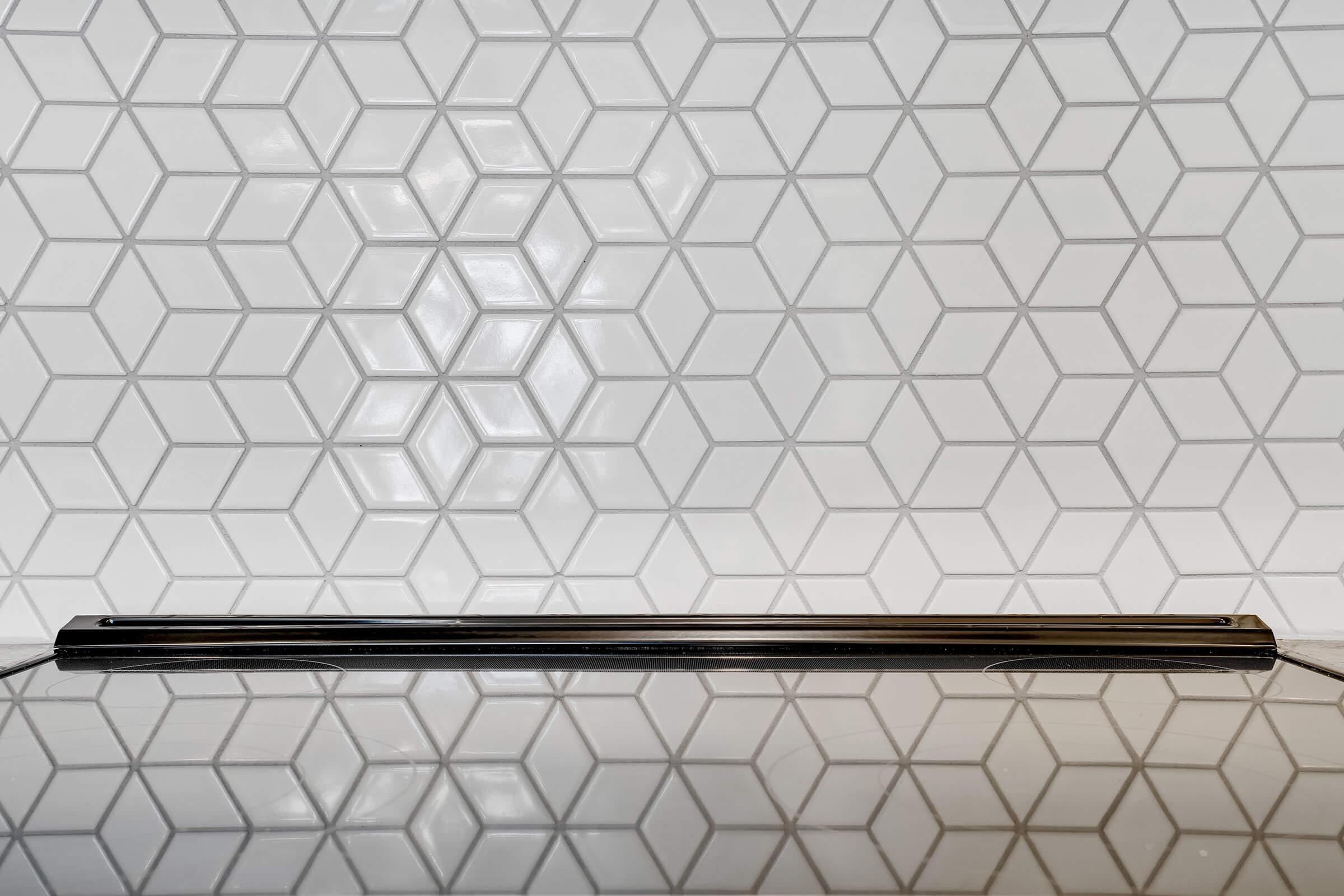 a close up of a tiled wall