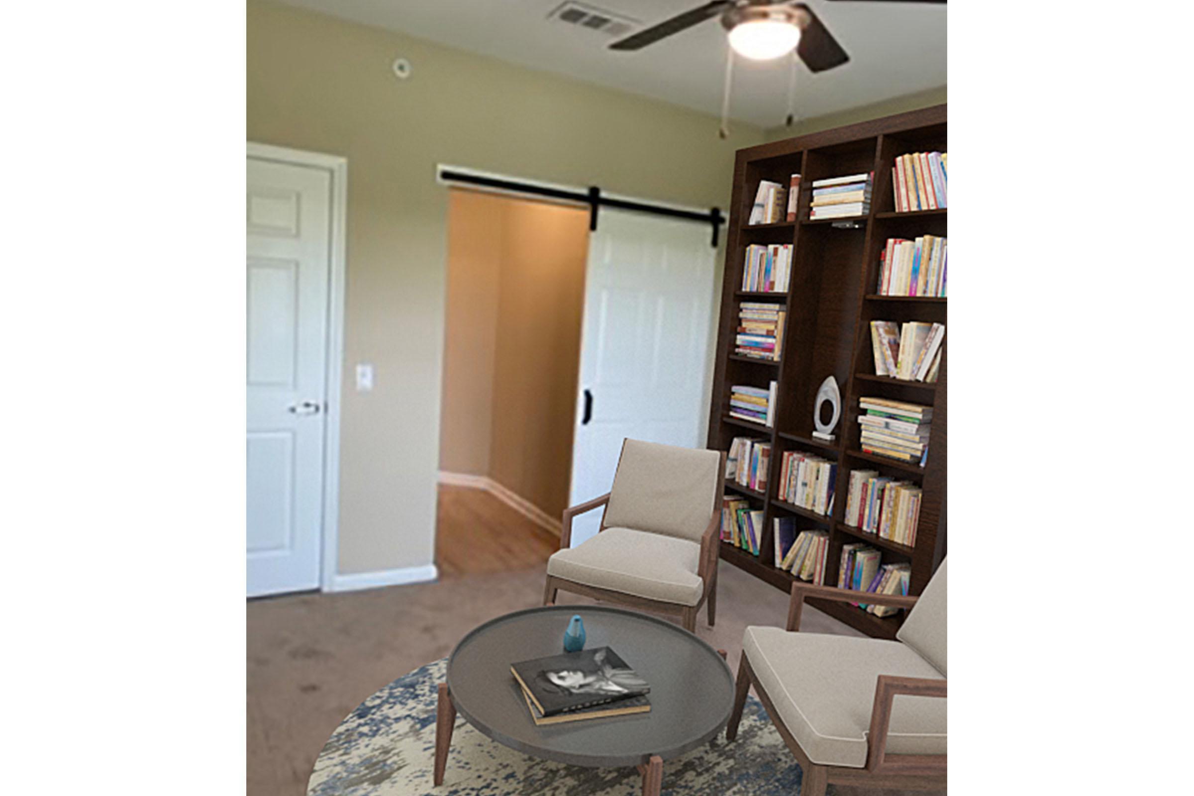 a living room with a book shelf