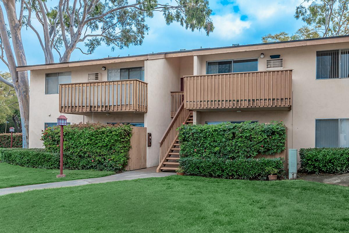 Villa Creek Apartment Homes community building with green shrubs