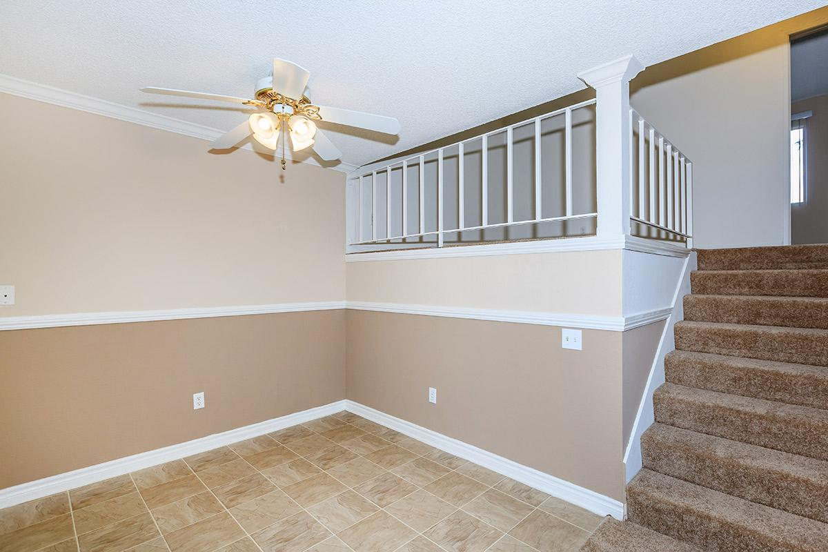 Dining room with carpeted stairs