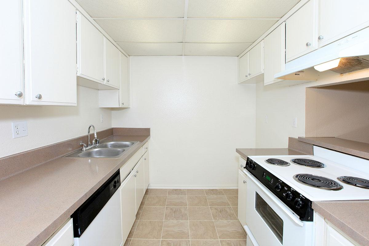 Vacant kitchen with white cabinets