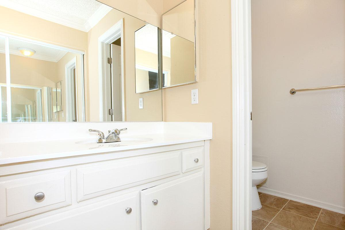Bathroom sink with white cabinets