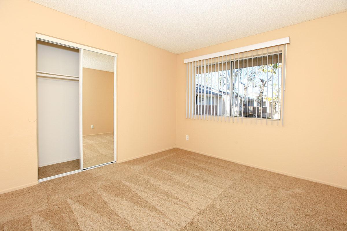 Vacant carpeted bedroom
