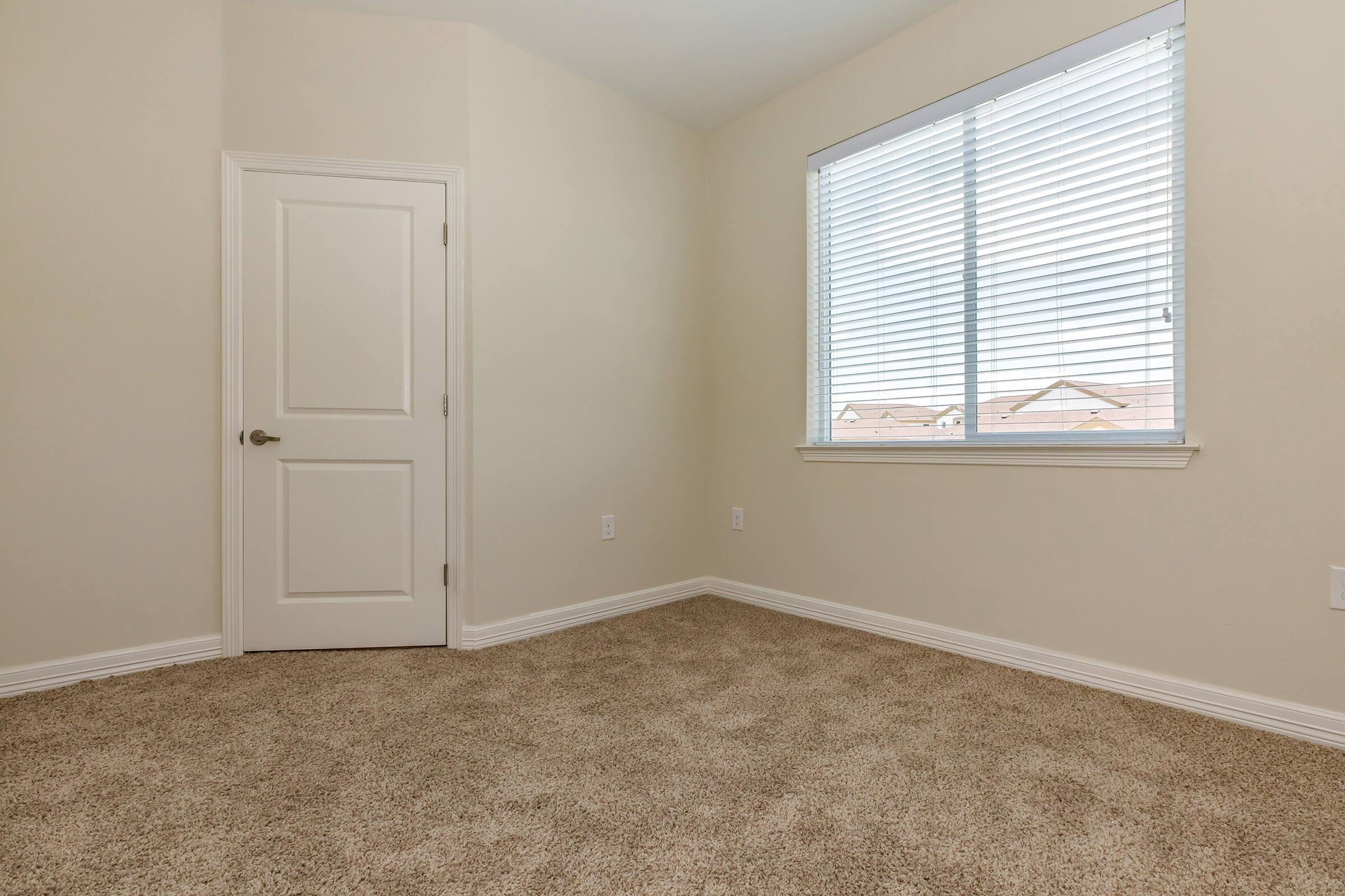 a bedroom with a large window