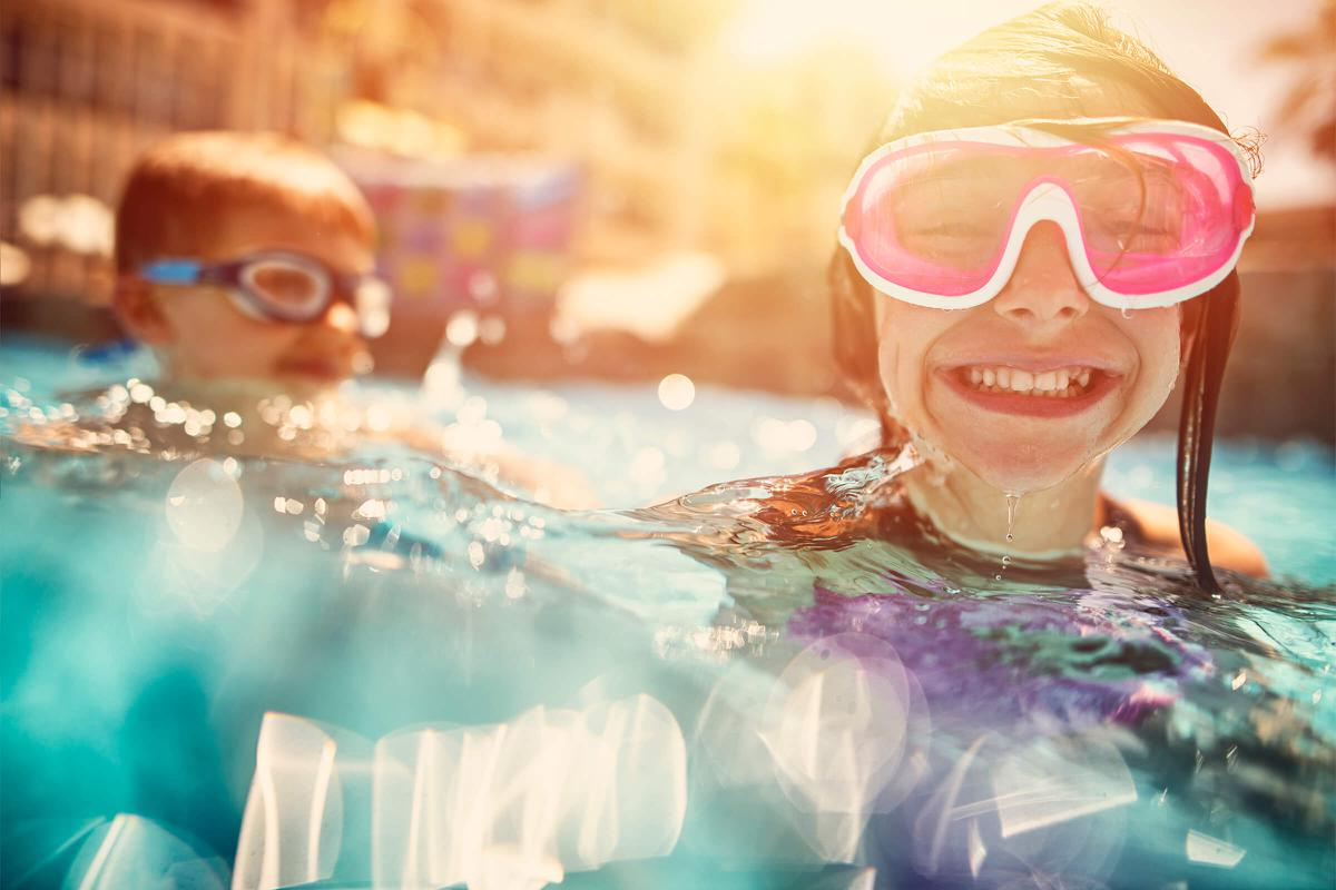 a person in sunglasses sitting in a swimming pool